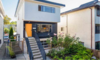 Modern home with Outdoor, Garden, Flowers, Front Yard, Walkways, Vegetables, Raised Planters, Gardens, Wood Fences, Wall, Metal Fences, Wall, and Horizontal Fences, Wall. Front Entrance Photo  of East Pender home