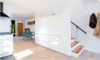 Modern home with Storage Room and Under Stairs Storage Type. Kitchen/Stairwell Photo 6 of East Pender home