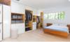 Modern home with Bedroom, Bed, Bookcase, Storage, Shelves, Ceiling Lighting, Recessed Lighting, and Light Hardwood Floor. Master Bedroom Photo 8 of East Pender home