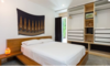 Modern home with Bedroom, Storage, Bed, Night Stands, Shelves, Lamps, Recessed Lighting, Ceiling Lighting, Accent Lighting, and Concrete Floor. Lower Suite Bedroom Photo 12 of East Pender home