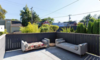 Modern home with Outdoor, Large Patio, Porch, Deck, Horizontal Fences, Wall, Wood Fences, Wall, and Rooftop. Back Deck Photo 14 of East Pender home