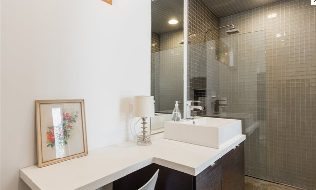 Bath Room, Vessel Sink, Open Shower, Concrete Floor, Corner Shower, Full Shower, Recessed Lighting, Glass Tile Wall, Ceiling Lighting, Table Lighting, and One Piece Toilet Lower Suite Bathroom  East Pender home