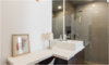 Modern home with Bath Room, Vessel Sink, Open Shower, Concrete Floor, Corner Shower, Full Shower, Recessed Lighting, Glass Tile Wall, Ceiling Lighting, Table Lighting, and One Piece Toilet. Lower Suite Bathroom Photo 16 of East Pender home