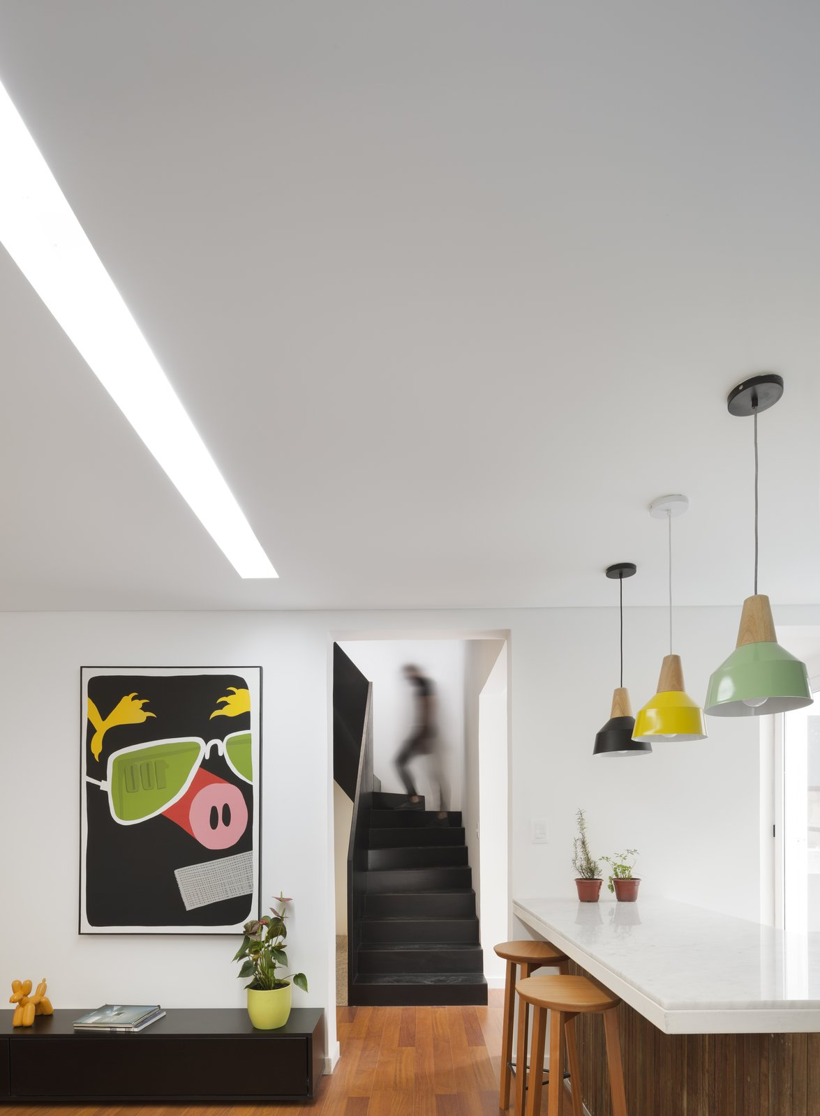 Kitchen, Marble Counter, Colorful Cabinet, Medium Hardwood Floor, Pendant Lighting, and Ceiling Lighting Interior  Casa Plaza by mass arquitectos