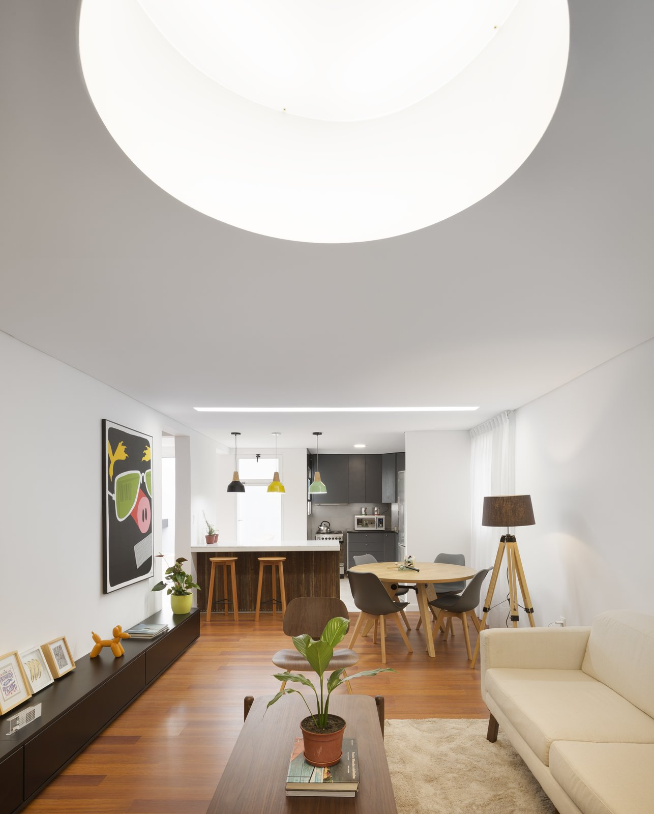 Living Room, Bench, Chair, Coffee Tables, Sofa, Console Tables, Ottomans, Pendant Lighting, Ceiling Lighting, and Medium Hardwood Floor Interior  Casa Plaza by mass arquitectos