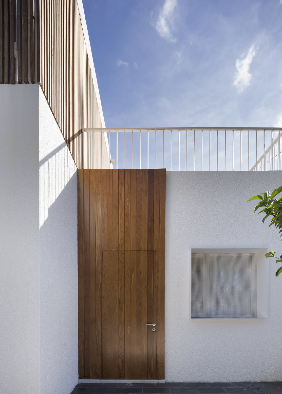 Doors, Exterior, Swing Door Type, and Wood Access  Casa Plaza by mass arquitectos