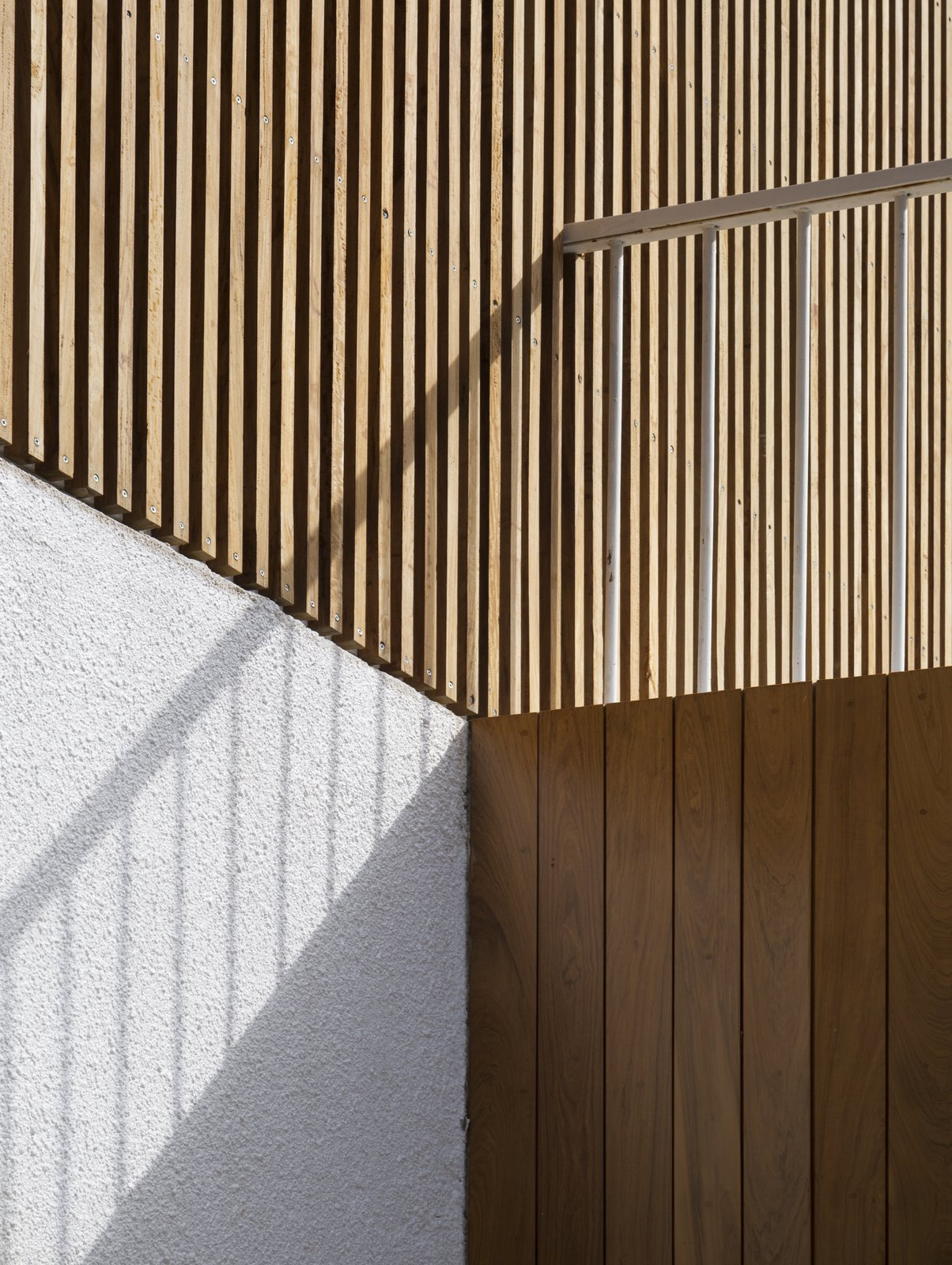 Outdoor, Vertical Fences, Wall, Wood Patio, Porch, Deck, Wood Fences, Wall, Concrete Patio, Porch, Deck, and Front Yard Detail  Casa Plaza by mass arquitectos