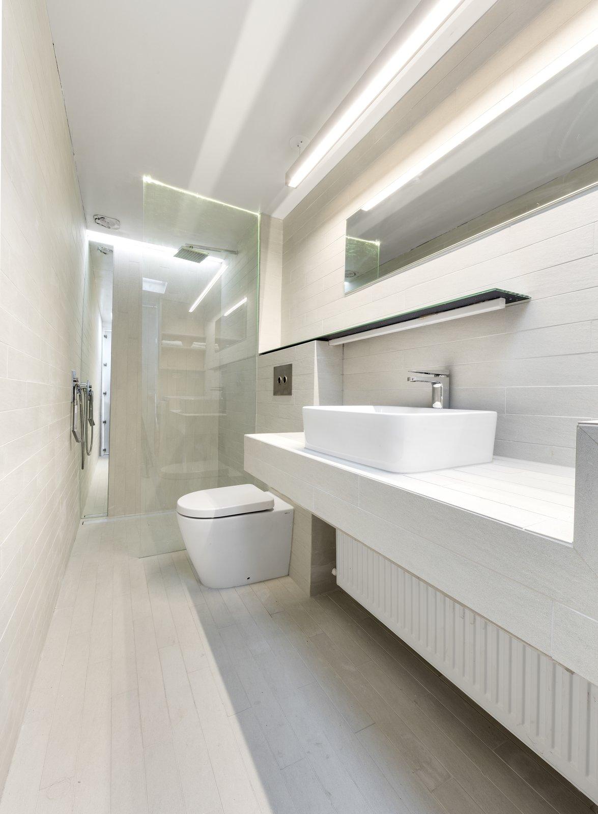 Bath Room, Tile Counter, Porcelain Tile Floor, Vessel Sink, Open Shower, Ceiling Lighting, Accent Lighting, Pendant Lighting, Porcelain Tile Wall, One Piece Toilet, and Recessed Lighting Bathroom  Curtain Cottage