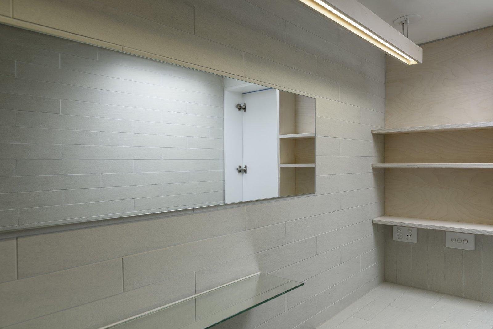 Bath Room, Tile Counter, Pendant Lighting, and Porcelain Tile Wall Bathroom detail  Curtain Cottage