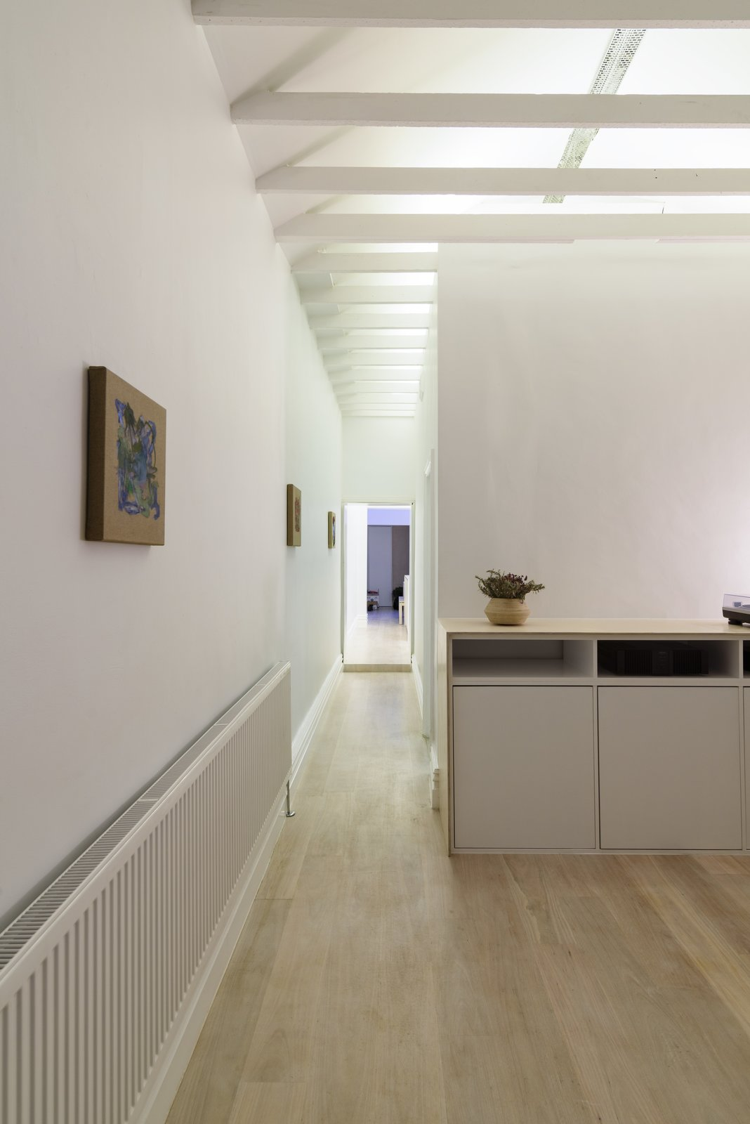 Light Hardwood Floor, Ceiling Lighting, Recessed Lighting, Console Tables, and Living Room Corridor (Night)  Curtain Cottage