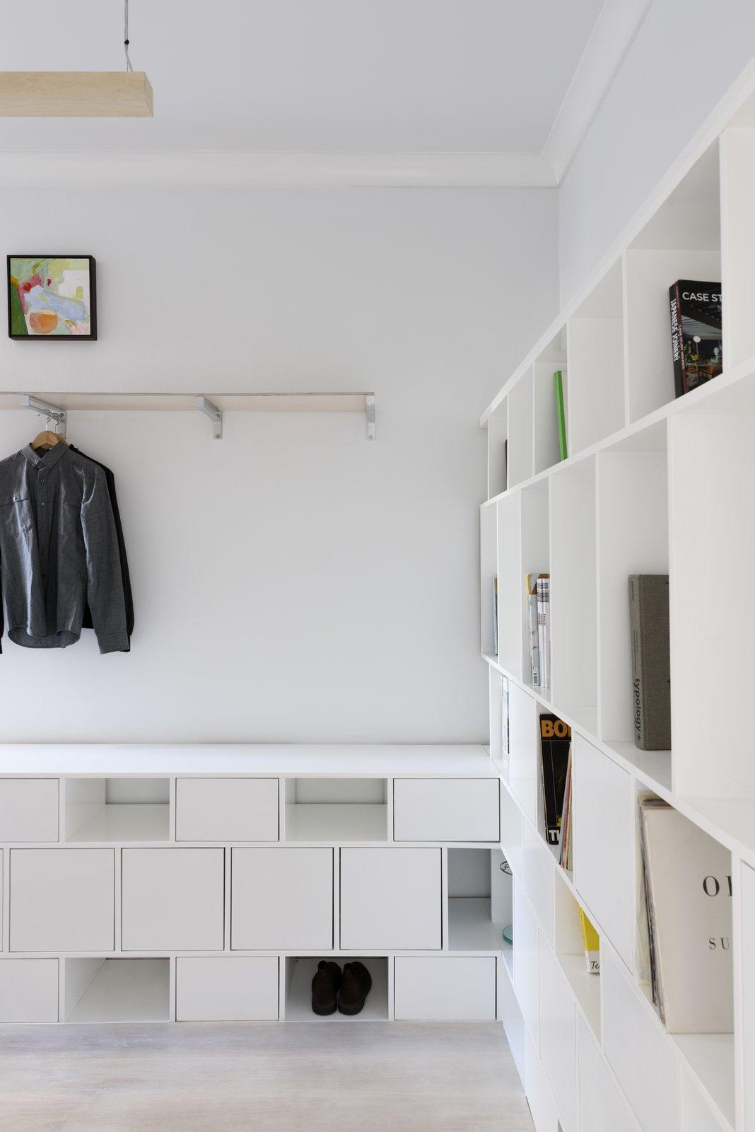 Shelves Storage Type, Shelves, Storage, Bookcase, Pendant Lighting, Light Hardwood Floor, and Bedroom Bedroom cabinetry  Curtain Cottage