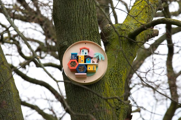 Honey I'm Home! by Hattie Newman is a Brazilian-style bee village created from an old IKEA BURVIK side table.