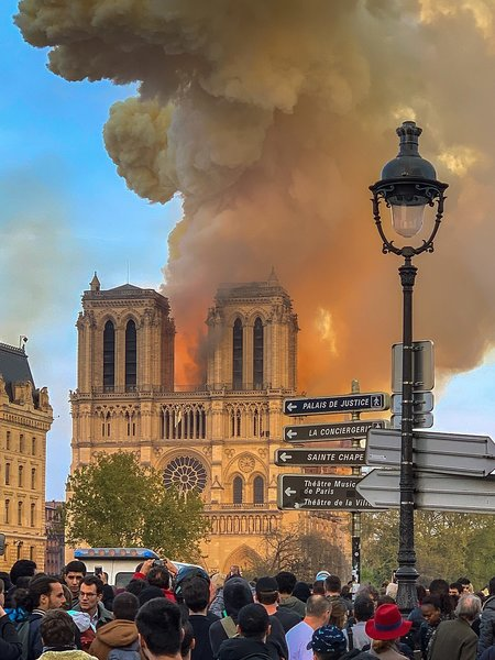 Crowds gathered as flames consumed one of Paris' most historic landmarks.  Photo 2 of 4 in €845M Pledged to Rebuild Notre Dame Cathedral After Devastating Fire