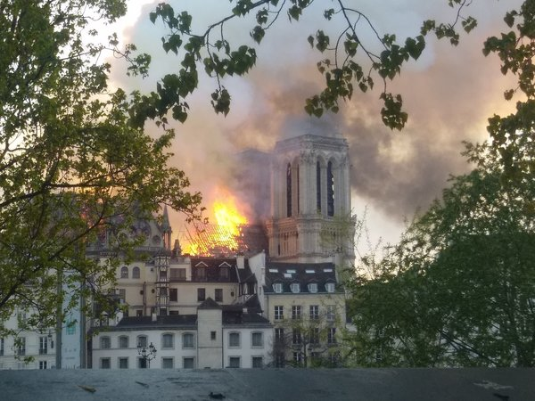 One of the cathedral's two towers can be seen here as the roof is engulfed in flames.