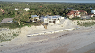 The Milam family installed a new retaining wall along the beach outside the home.