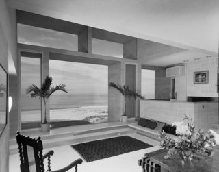 Large windows throughout the home frame views of the Atlantic Ocean.