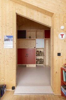 The cabin's mudroom also houses a wood storage facility to help keep the fire burning on cold Norwegian nights.