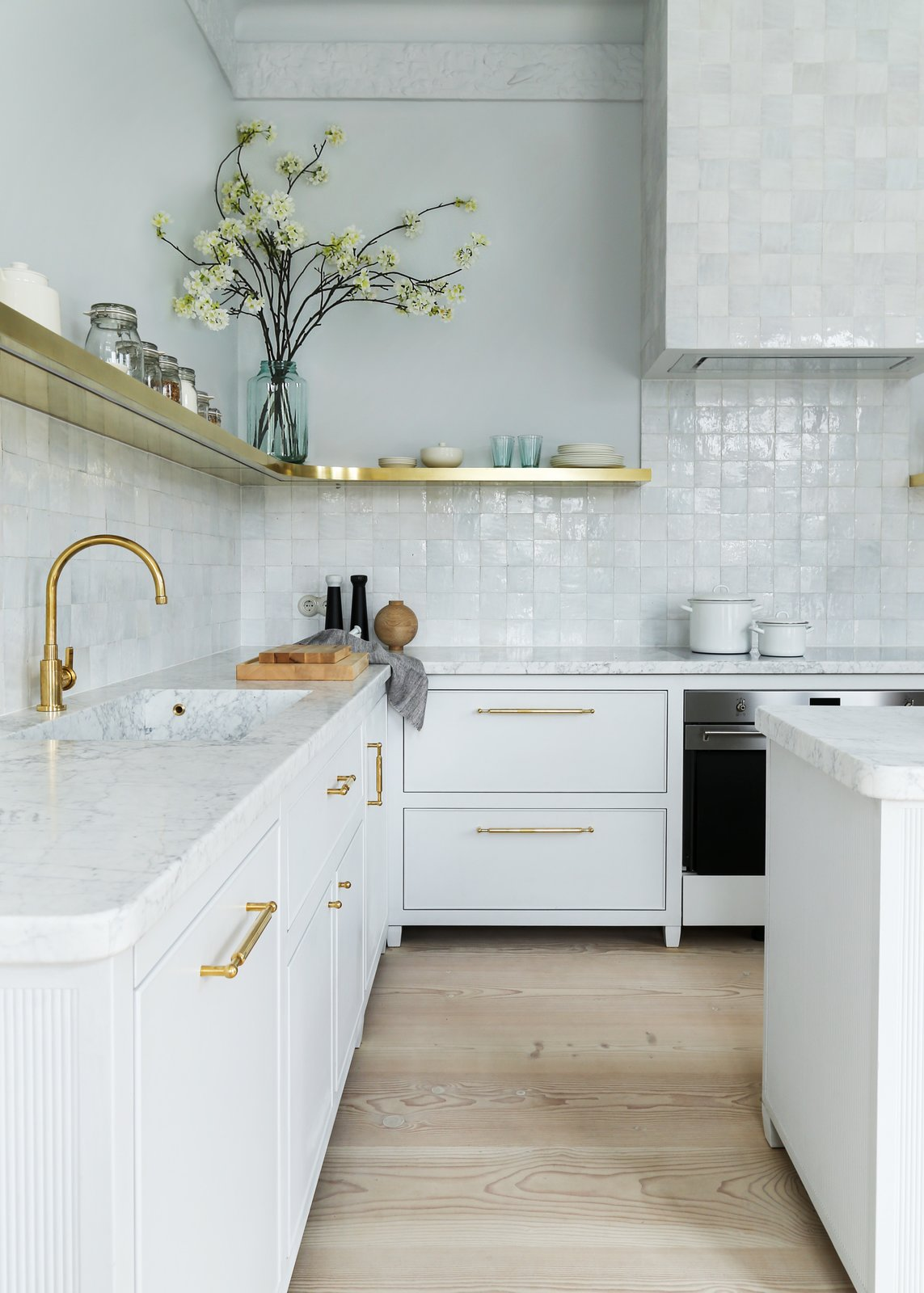Keren Richter selected an unlacquered brass faucet by Studio Ore to sit above a White Arrow custom-designed integrated marble sink in this pre-war Berlin renovation.  Photo 6 of 11 in How Much Should You Spend on a Kitchen Faucet?