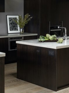 """For this Seattle, Washington, home designer Charlie Hellstern selected concrete countertops. """"Inherently durable, made sustainably, and it fit with the modern aesthetic of the home,"""" she says."""