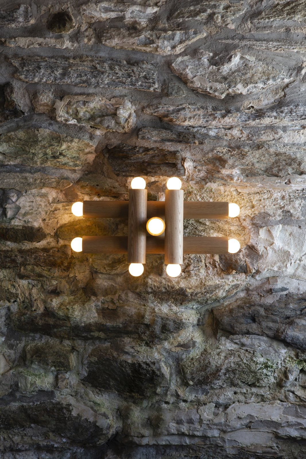 Workstead's 9-bulb Hieroglyph sconce ($2,950) is made of nested wood cylinders.  Photo 11 of 12 in How Much Should You Spend on a Wall Sconce?