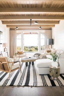 A Pampa rug from Argentina adorns this light-filled living room designed by Cortney Bishop.