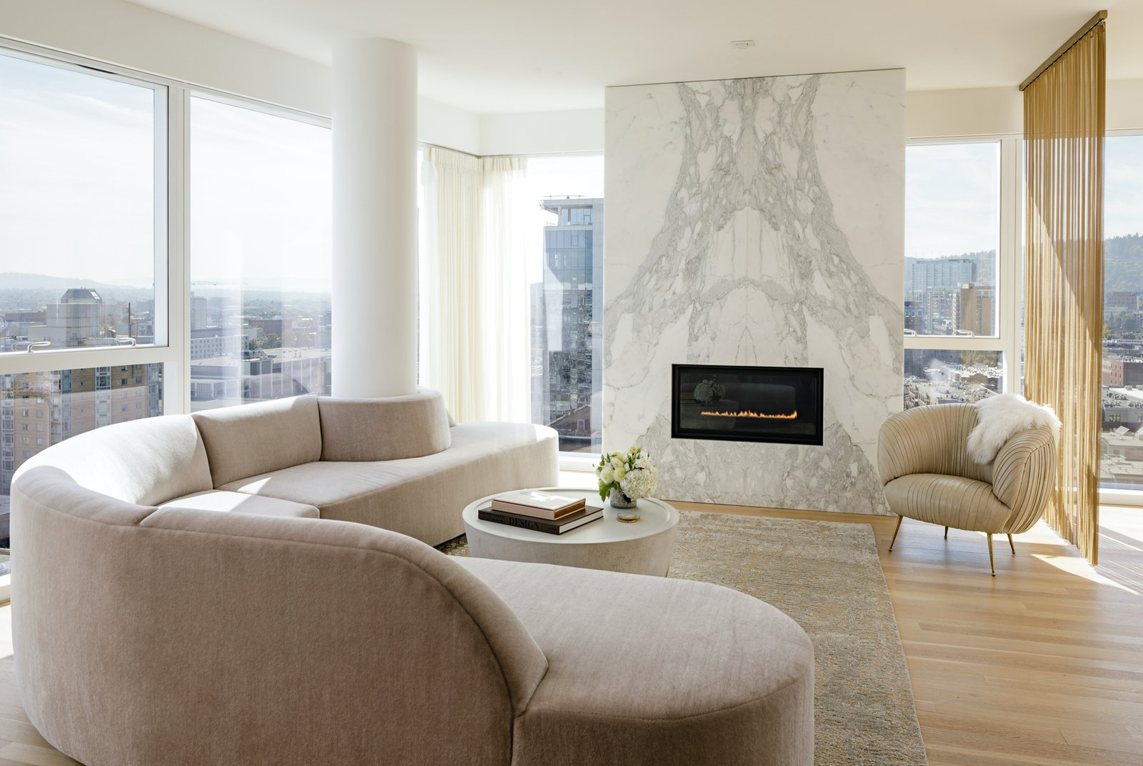Functional curtains are key in this Portland penthouse by JHL Design, where oversize windows let in abundant sunlight and views.  Photo 2 of 14 in How Much Should You Spend on Curtains?