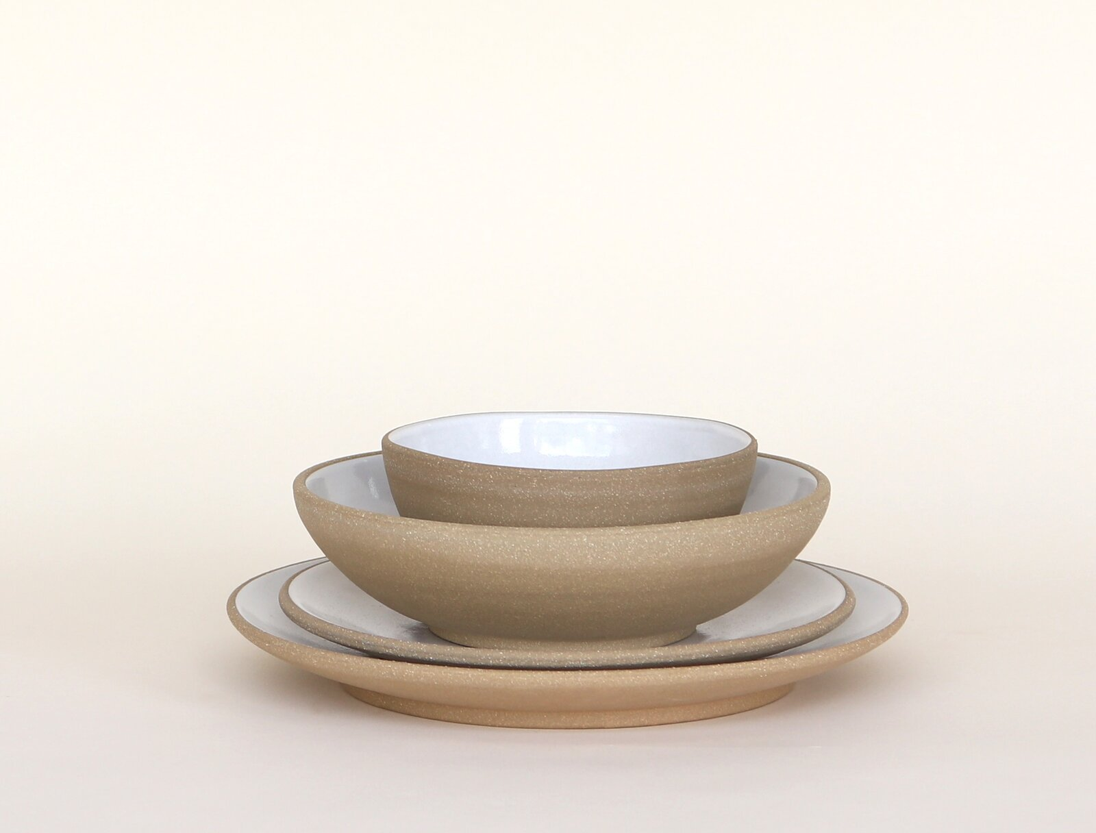 Dining Room Jono Pandolfi's Coupe four-piece setting in Toasted Clay is his most popular setting, and costs $140 for four pieces including an entrée plate, salad plate, cereal bowl, and an Alaska (soup/salad) bowl.   Photo 9 of 9 in How Much Should You Spend on Dinnerware?