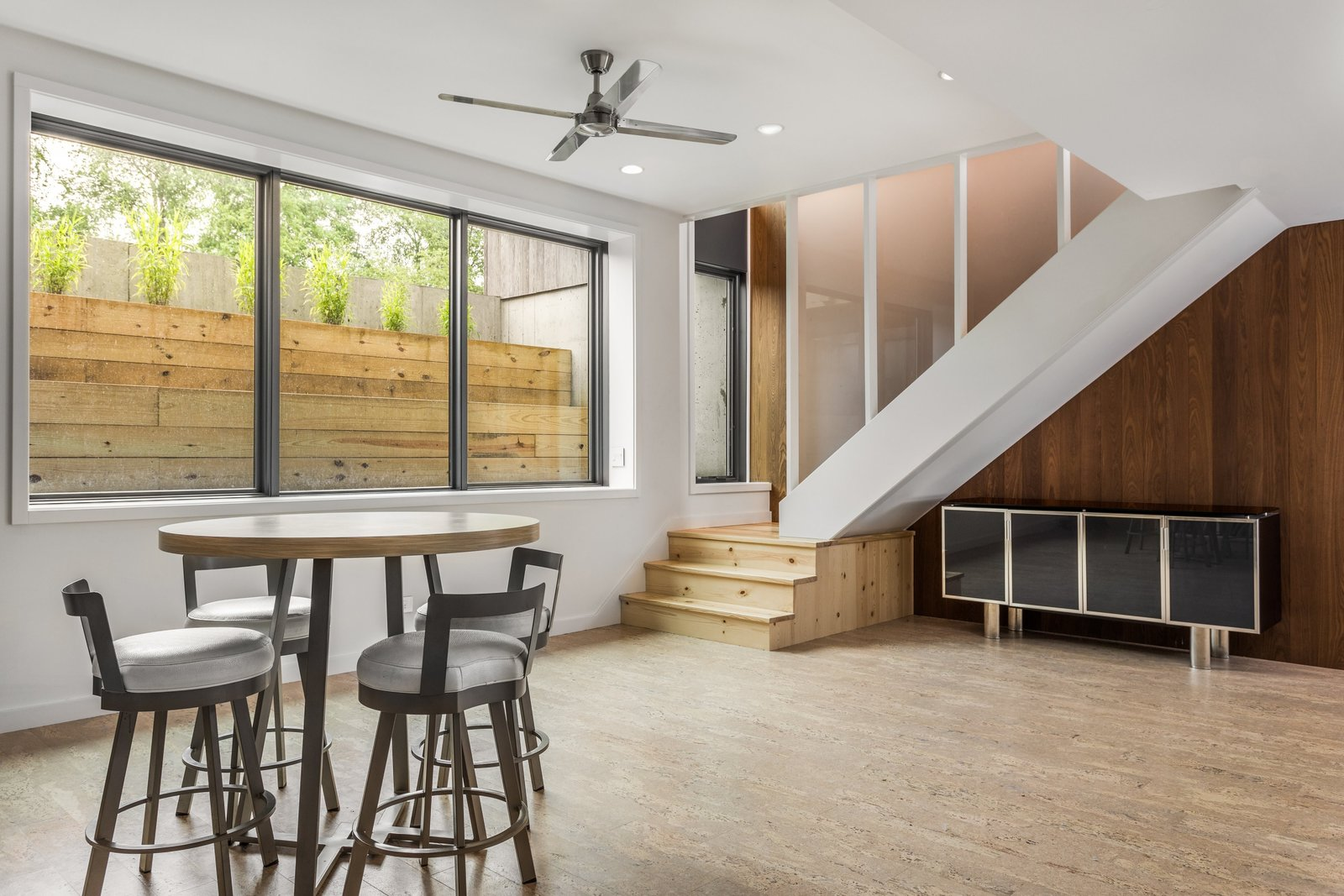 Cork Floor, Coffee Tables, Stools, Ceiling Lighting, Chair, Staircase, Wood Tread, and Metal Railing The basement was designed to enjoy natural light.   Copperwood by Kevin Swan