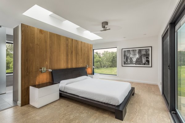 The bedroom features a floating wall, with beautiful views on three sides.