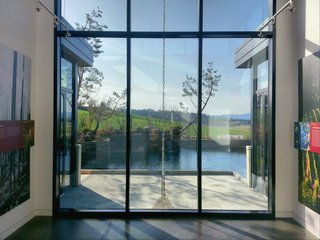 The tasting room celebrates rainwater as it flows off the roof, down a rain chain, and into the pond.