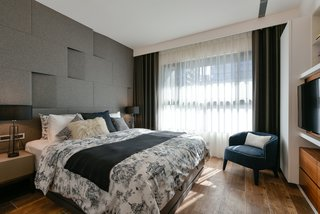 The older couple's bedroom contains large amounts of storage space, which is in accord with their living habits.