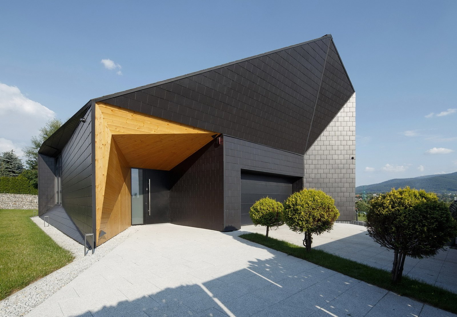 Exterior, Wood Siding Material, Brick Siding Material, House Building Type, Stone Siding Material, and Gable RoofLine Entrance zone  BLACK ROCK by MUS ARCHITECTS