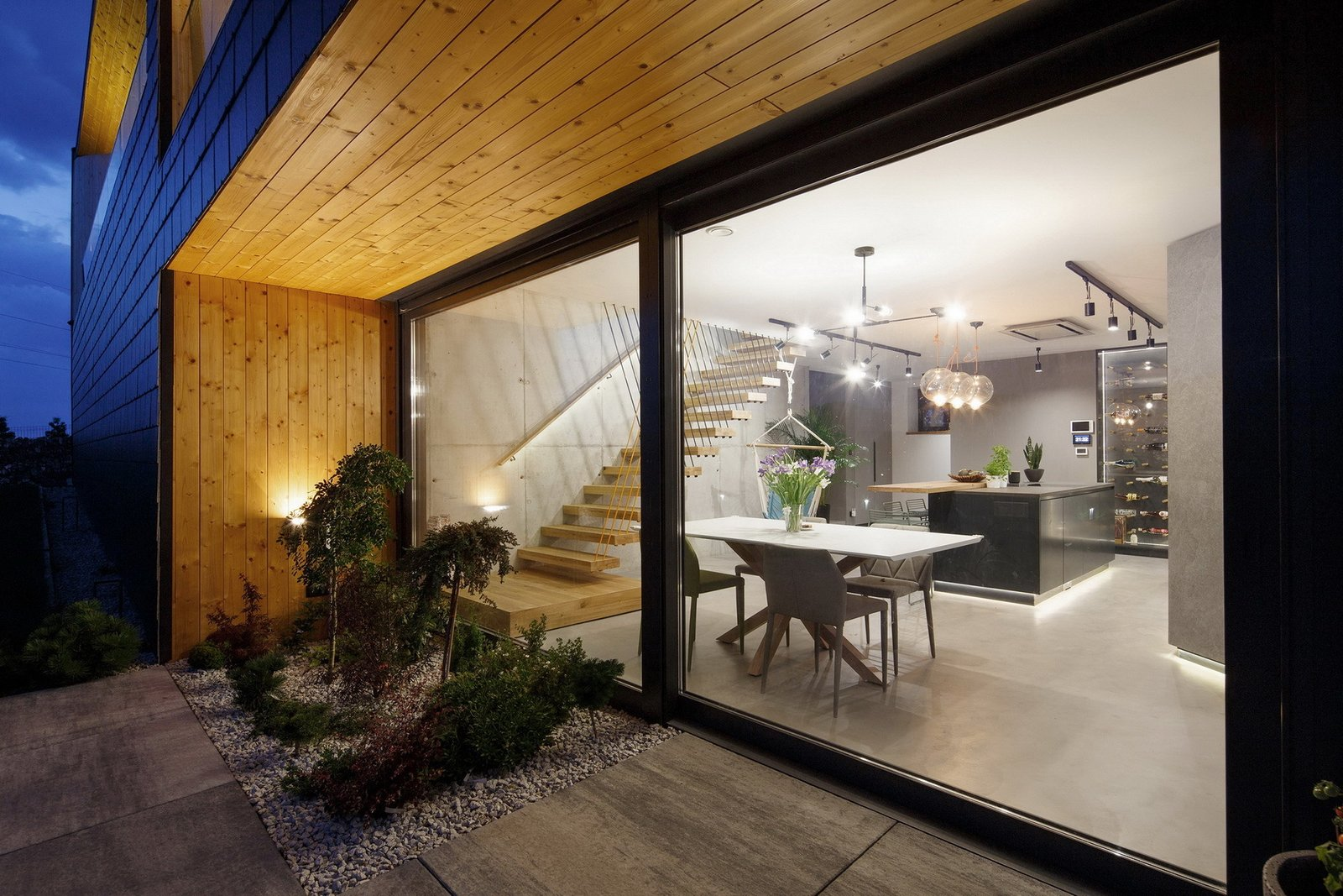 Exterior, Concrete Siding Material, House Building Type, Wood Siding Material, Stone Siding Material, and Gable RoofLine Dinning room view from the terrace  BLACK ROCK by MUS ARCHITECTS