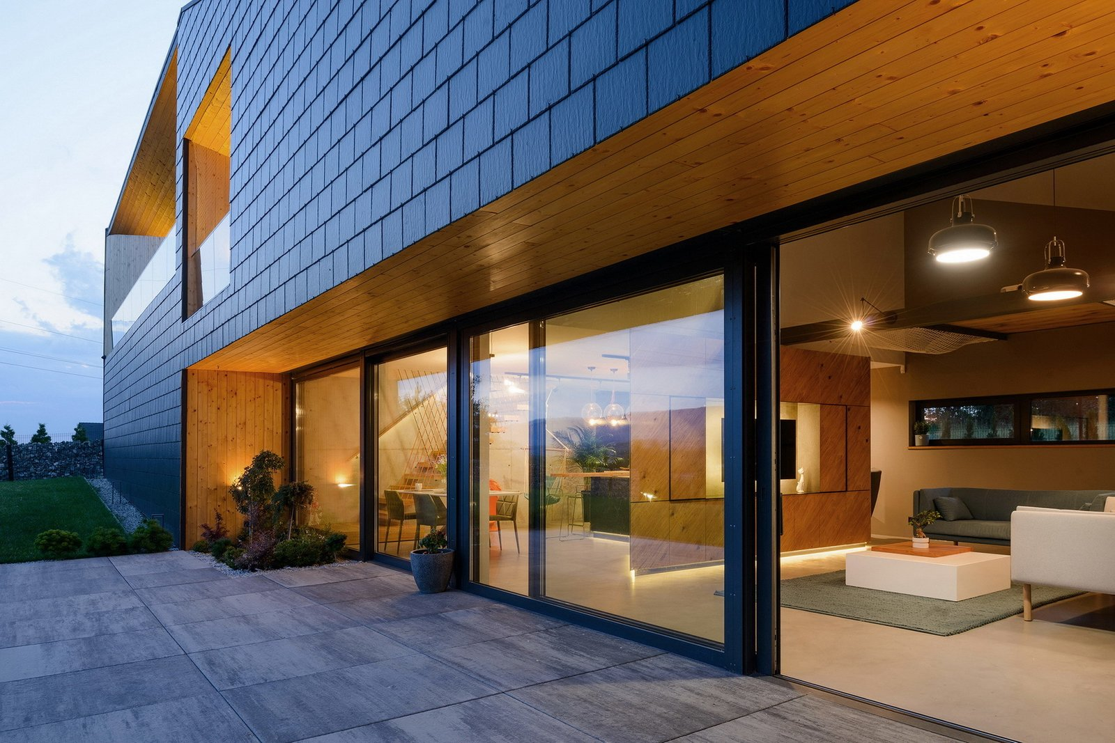 Exterior, Tile Roof Material, Gable RoofLine, Stucco Siding Material, House Building Type, Stone Siding Material, and Wood Siding Material Terrace  BLACK ROCK by MUS ARCHITECTS