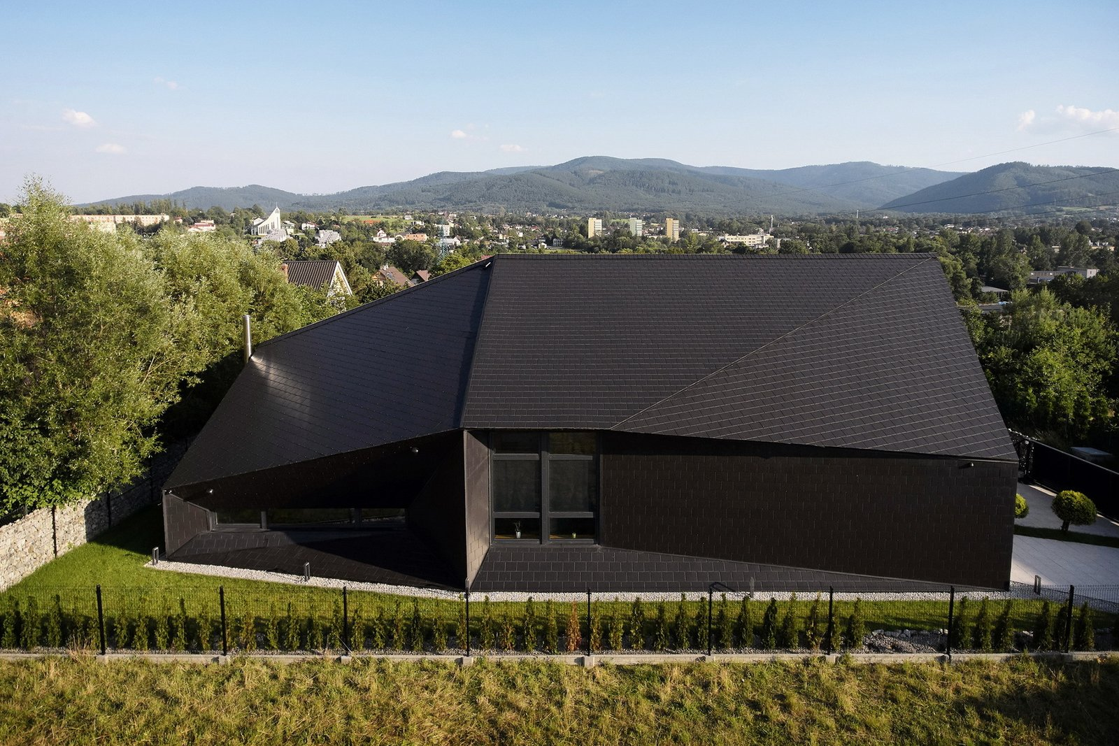 Exterior, House Building Type, Stone Siding Material, Tile Roof Material, and Gable RoofLine Aerial view from the north - house and the mountains.  BLACK ROCK by MUS ARCHITECTS