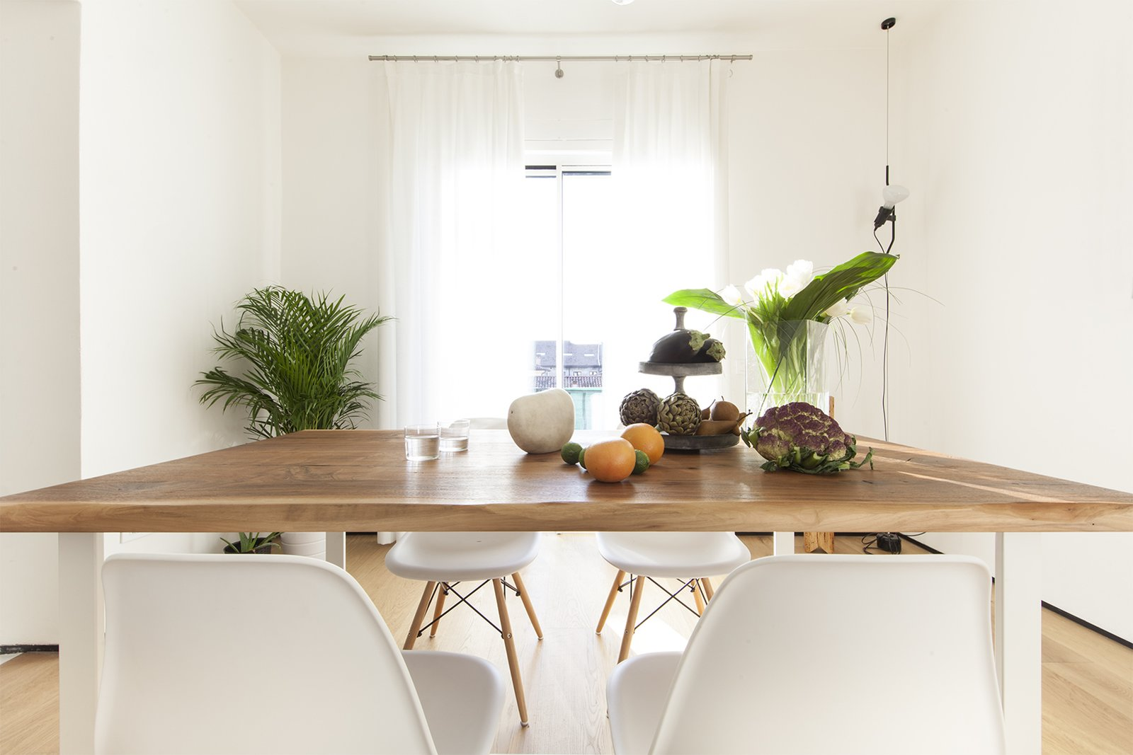 Dining Room, Light Hardwood Floor, and Pendant Lighting dining room  Iterior DM by Didonè Comacchio