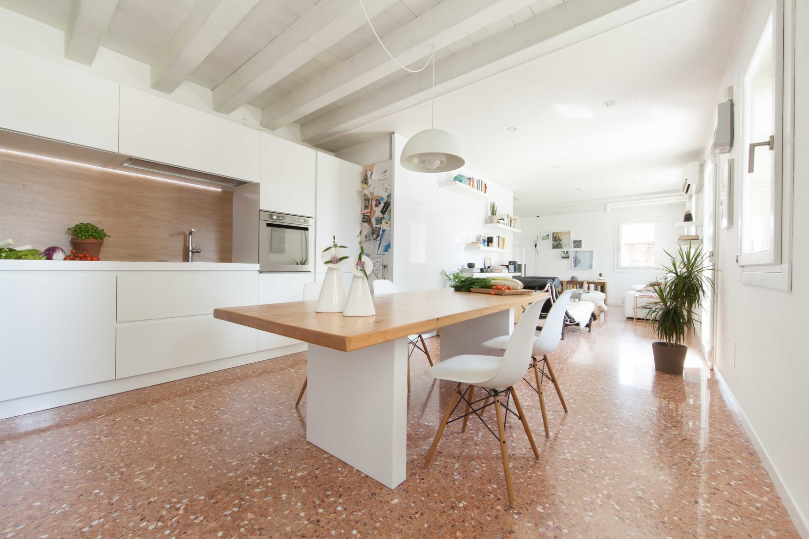 Kitchen, White Cabinet, Pendant Lighting, and Marble Floor kitchen  House PB by Didonè Comacchio