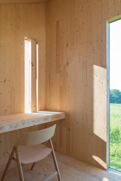 With an interior clad in wood and outfitted with a CLT bench and desk that laterally brace the small structure, this mobile writing shed is simple but effective. We love the idea of using a few pieces of carefully chosen furniture, especially for a she shed, where space is precious, but the use of the space might be a bit more focused.