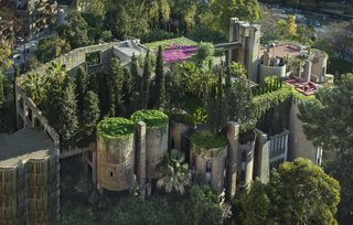 Lush plantings espalier the concrete walls of the Ricardo Bofill Taller de Arquitectura headquarters.
