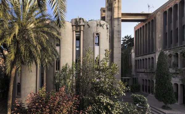 In the mid-1970s, architect Ricardo Bofill transformed the abandoned Sansón Cement Factory, which is five miles outside Barcelona in the village of Sant Just Desvern, into his home and the headquarters for his firm. The former cement factory's grounds were brought to life with Mediterranean plantings.