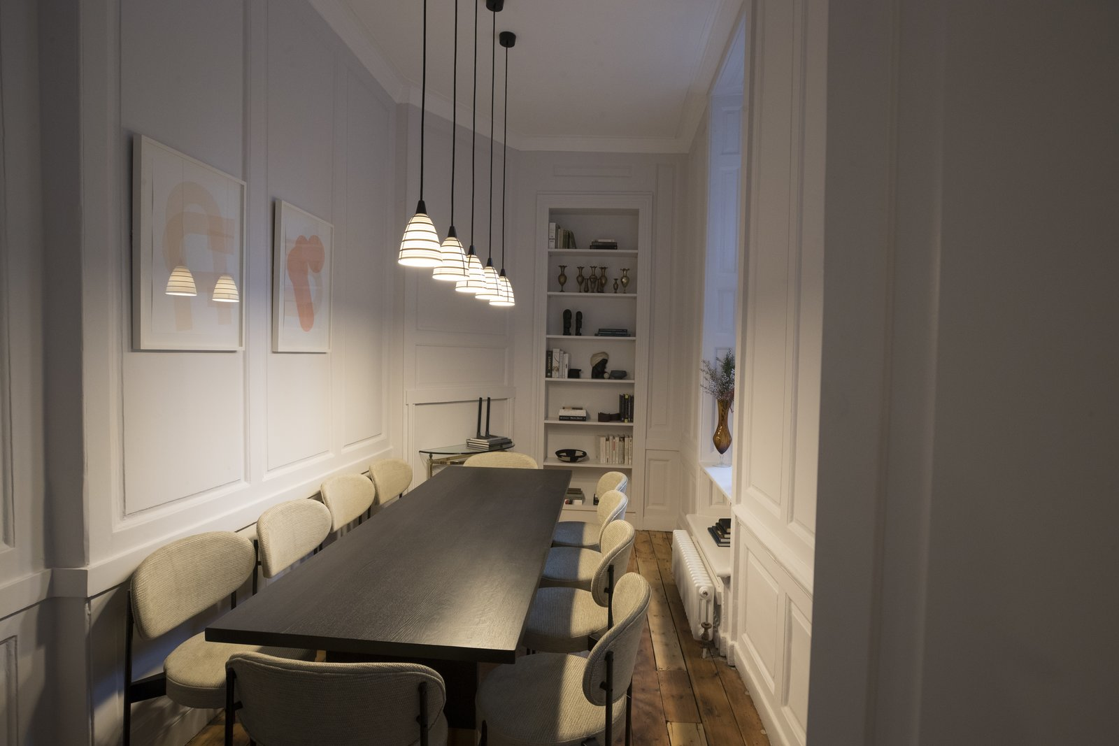 Office, Shelves, Desk, Medium Hardwood Floor, and Chair A conference room with comfortable contemporary furnishings provides space for large meetings.    Photo 5 of 17 in 6 Co-Working Clubs Catered to Women That Radiate Good Vibes and Beautiful Designs