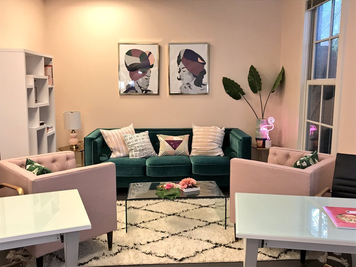Living Room, Coffee Tables, Table Lighting, Chair, Rug Floor, and Sofa Clean lines and rich textiles give Detroit's Femology a fun and funky vibe.    Photo 13 of 17 in 6 Co-Working Clubs Catered to Women That Radiate Good Vibes and Beautiful Designs