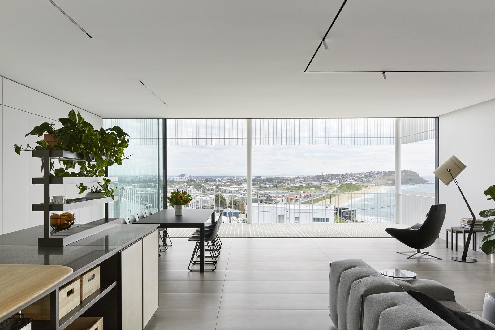 Dining Room, Chair, Table, Ceiling Lighting, and Floor Lighting A transparent balcony allows unobstructed views of the sea and Newcastle's skyline.  Best Photos from A Futuristic Abode in Australia Draws Inspiration From Star Wars