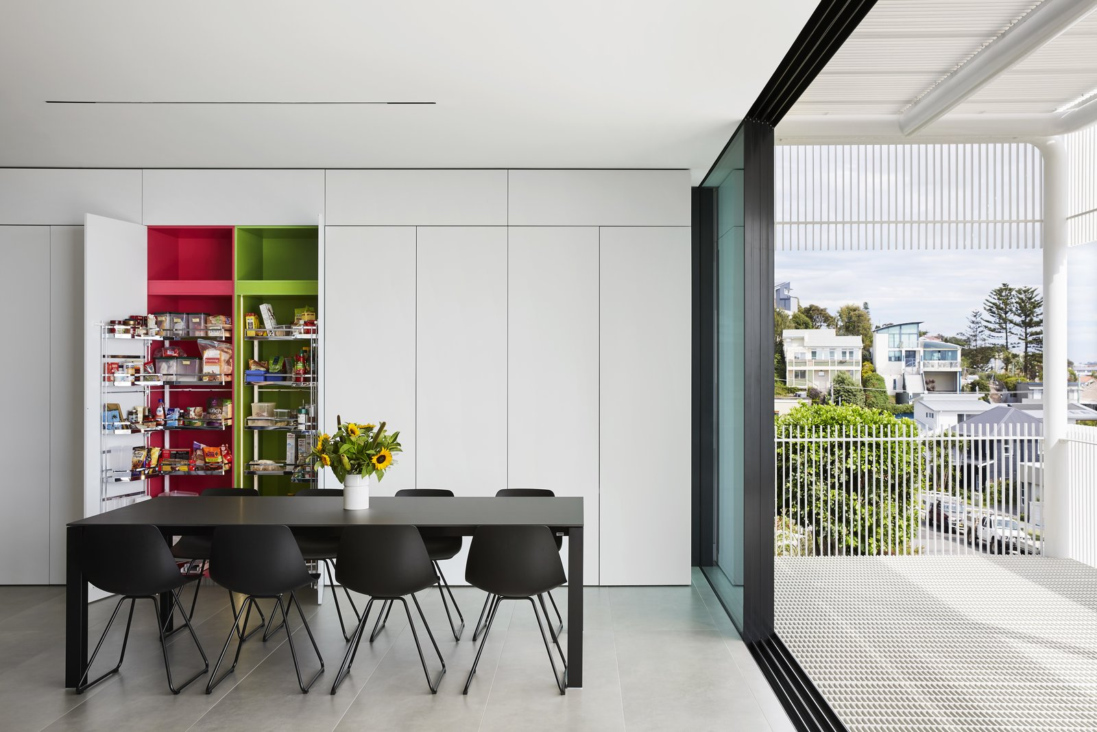 Dining Room, Storage, Table, and Chair Sleek cabinetry extends from the kitchen into the dining room for extra storage.  Best Photos from A Futuristic Abode in Australia Draws Inspiration From Star Wars