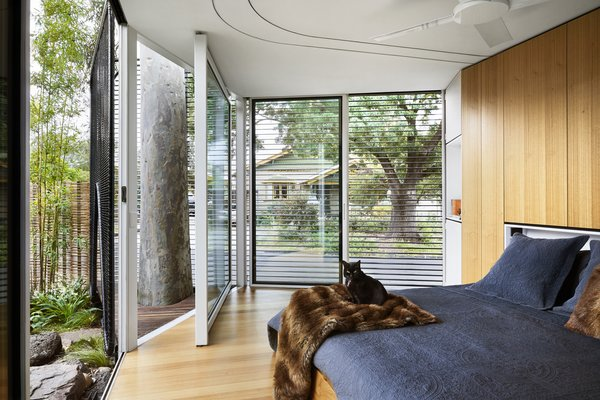 Although the master suite overlooks the back street, shutters offer privacy.