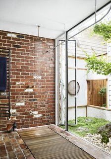 A private garden is accessible by a glass panel.