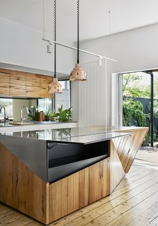 The stainless-steel and timber island maximizes space with a secret hatch that opens to add extra surface area for food prep.