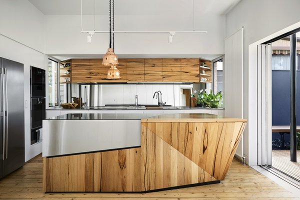 The kitchen cabinetry was fabricated using 100-year-old timber salvaged from Yarraville's sugar mills.