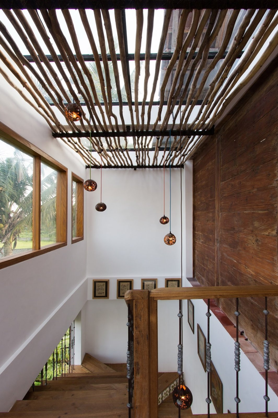 Staircase, Wood Railing, and Wood Tread Bedrooms suites are located in five traditional Javanese bungalows that are spread throughout the lush property.  Photo 7 of 12 in These 3 Co-Living Companies Are Transforming Urban Living