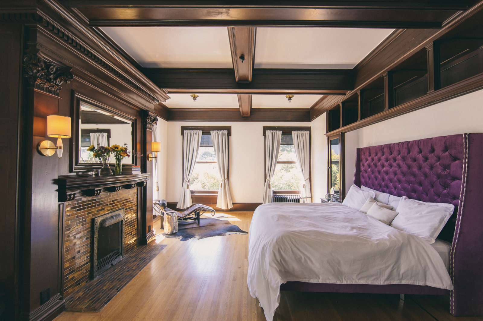 Bedroom, Bed, Ceiling Lighting, Wall Lighting, and Medium Hardwood Floor Renters can stay the night for $220 an evening or $4,000 a month.  Photo 11 of 12 in These 3 Co-Living Companies Are Transforming Urban Living